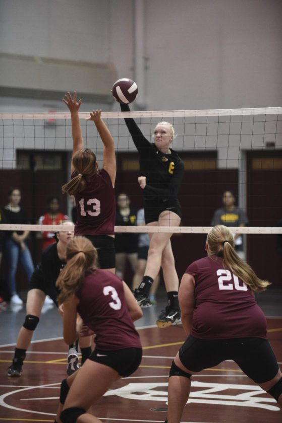 OBSERVER File Photo Forestville's Brooke Ostrye knocks the ball over the net during a regular season match. The CCAA North First Team All-Star had 62 points in the poll, trailing only Jenna Caskey's 69.