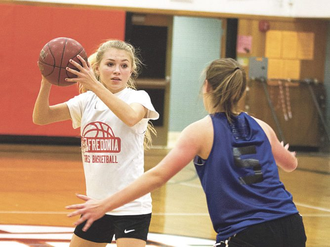 OBSERVER Photo by Mary Ann Wiberg Fredonia guard Kazlin Beers looks for the pass against Westfield defender Susie Wolfe (5) in a non-league varsity girls' basketball scrimmage held at Fredonia High School.