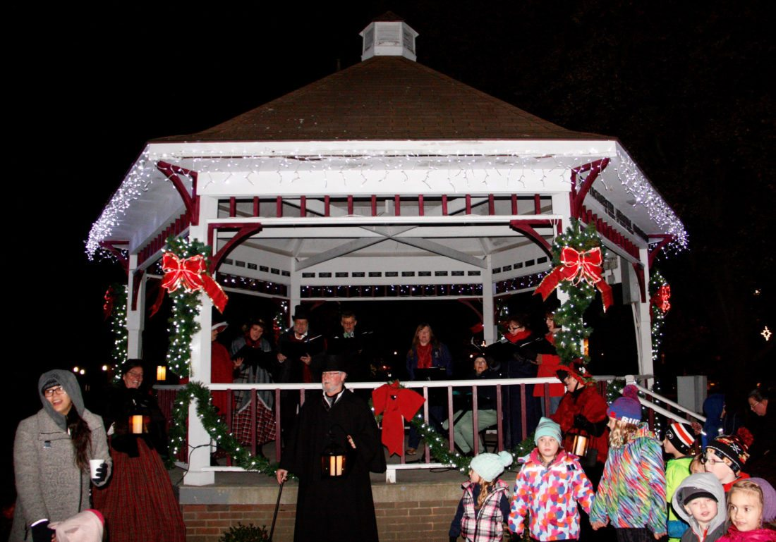 OBSERVER Photo by Tonja Dodd A Dickens Christmas weekend is kicked off in Moore Park Friday, November 17, 2017 in Westfield. Carolers and families gather at the gazebo while awaiting Santa to light the Christmas tree.