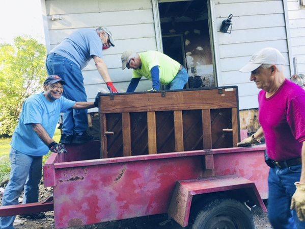 Rick Marable, Frank Koletar, Dave Kurzawa and Mark Halter moving a piano out of the house at 29 Monroe St.