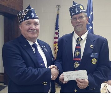 Submitted Photo At left: Dunkirk Memorial Post 62 Commander Jim Lemanski is thanked for Post 62's donation to help with county Legion projects by Chautauqua County Commander Paul Oyer.