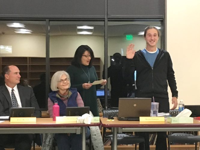 OBSERVER Photo by Andrew David Kuczkowski Pictured is Andrew Kruszka, far right with hand in air, taking the oath of office with district clerk Kathy Ferneza swearing him in. Board President Cynthia Sutherland, in front of Ferneza, and Gowanda Superintendent James Klubek look on.