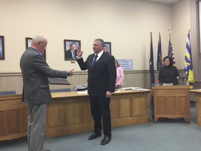 OBSERVER Photo by Jimmy McCarthy Dan Gard was appointed as the village of Fredonia's new attorney during a special meeting Monday. Gard was sworn in by Village Administrator Richard St. George.