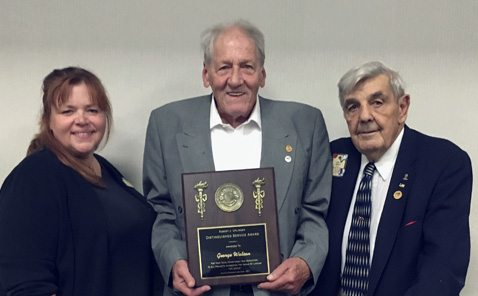 Submitted Photo Pictured from left are July Cole, Dunkirk-Fredonia Lions Club president; Lion George Watson and John Banach, current Lion and former district governor.