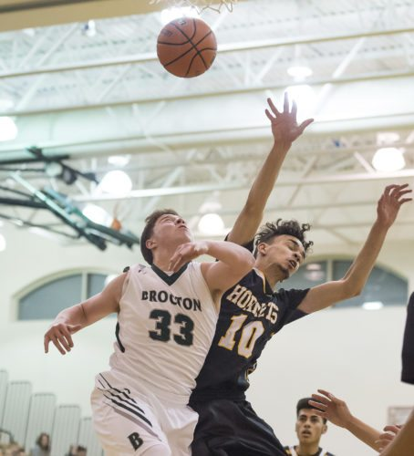 OBSERVER Photos by Ron Szot Brocton's Caleb Chelton (33) and Forestville's Orlando Soto (10) fight for a rebound during Tuesday's high school basketball game in Brocton.