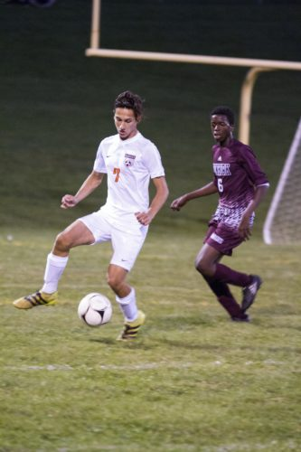 OBSERVER File Photo Fredonia's Jason Genovese (7) plays the ball as Dunkirk's Meracle Berakah (6) pursues during an Oct. 2 regular season match. Genovese is part of the First Team of the CCAA West Division boys soccer All-Stars, while Berakah is on the Second Team.