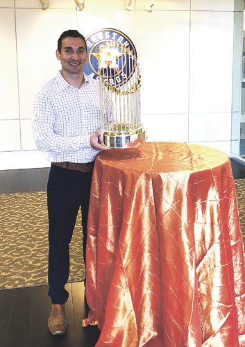 Submitted photo Shown here is Dunkirk native Mark Cole holding the Houston Astros' 2017 World Series Championship Trophy. A 2005 sports studies graduate of St. John Fisher College, his degree took him to the Class A Brooklyn Cyclones and the Class AAA Scranton-Wilkes Barre Yankees. From there, he went to West Virginia University where he obtained his master's degree in sports management. He has been with the Houston Astros for seven years, working his way up to his present position, Director of Ticket Operations. He resides in Spring, Texas, with his wife, Dr. Tori Cole, and their two sons, Asher and Maddox.