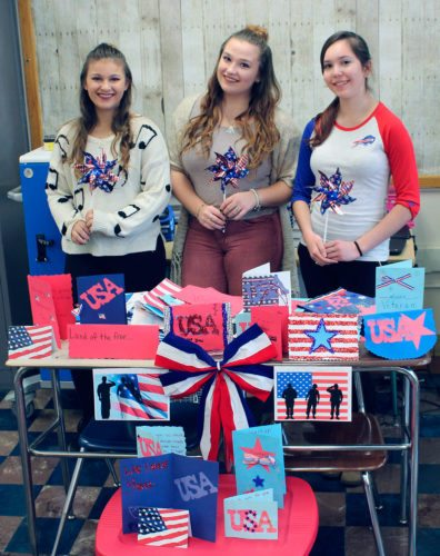 Submitted Photo The Cassadaga Valley High Key Club along with the government, art, and ELA classes made over 100 cards to be distributed by the Northern Chautauqua Community Foundation to local veterans. Pictured left to right are: Desiree Ziolkowski, Olivia Bishop and Courtney Hays.