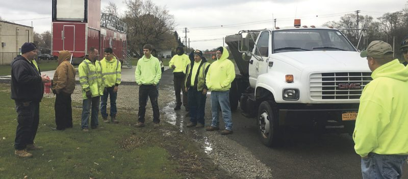 "Submitted Photo Pictured are the training crews outside reviewing a City salt spreader truck and listening to instructions from Streets Supervisor Michael Porpiglia on the best ways to ""stay ahead of the storm."""