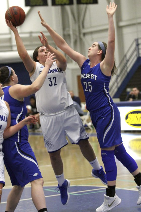 OBSERVER Photo by Lisa Monacelli Fredonia's Jenna Einink, a Westfield native and Chautauqua Lake High School graduate, goes up for a shot against Hilbert's Katelyn Proy (25) during Monday's game at Steele Hall.