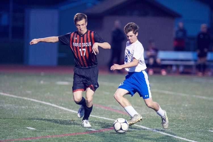 Westfield-Brocton's Jason Almeter (18) advances the ball as Maple Grove's Wyatt Chriest (17) defends during a Section VI Class C boys soccer semifinal on Oct. 23. Almeter is the CCAA Central boys soccer Player of the Year on the division's list of All-Stars.