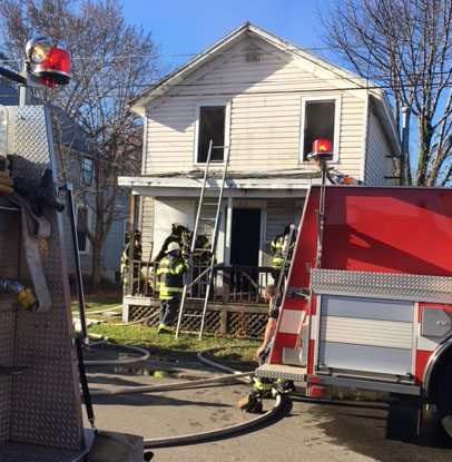 Dunkirk firefighters battle a blaze at 313 Pelican St. this morning.