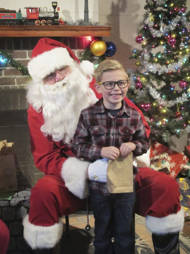 OBSERVER File Photo Jason Mills sits on Santa's lap at the Kiwanis Club of Silver Creek's Christmas in the Park.