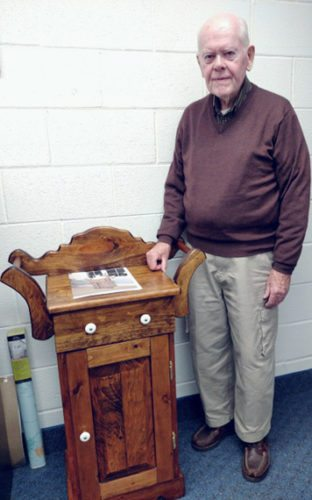 Submitted Photo Bob Sutehall stands next to the hand-crafted, antique-style washstand he made and has donated for the Friends of the  Anderson-Lee Library Holiday Raffle taking place in December.
