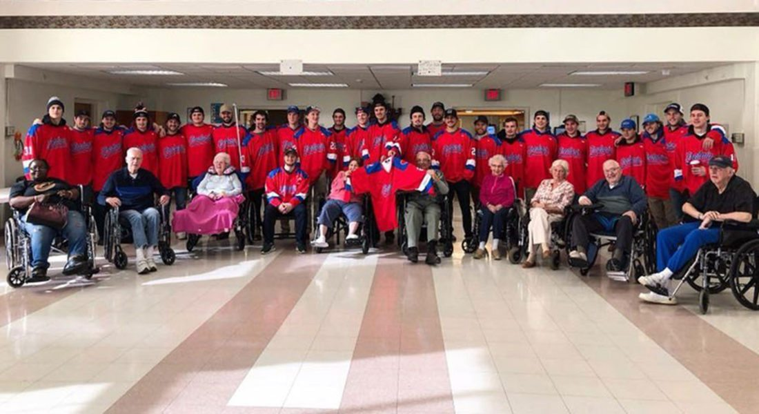 Submitted Photo The Fredonia men's hockey team poses with residents of the Chautauqua Nursing and Rehabilitation Center.