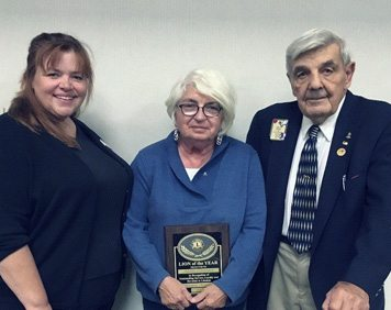 Submitted Photo Lion Joann Ehrhardt was awarded 2017 Lion of the Year. Pictured from left are: Judy Cole, Dunkirk-Fredonia Lions Club president; and John Banach, current Lion and former district governor.