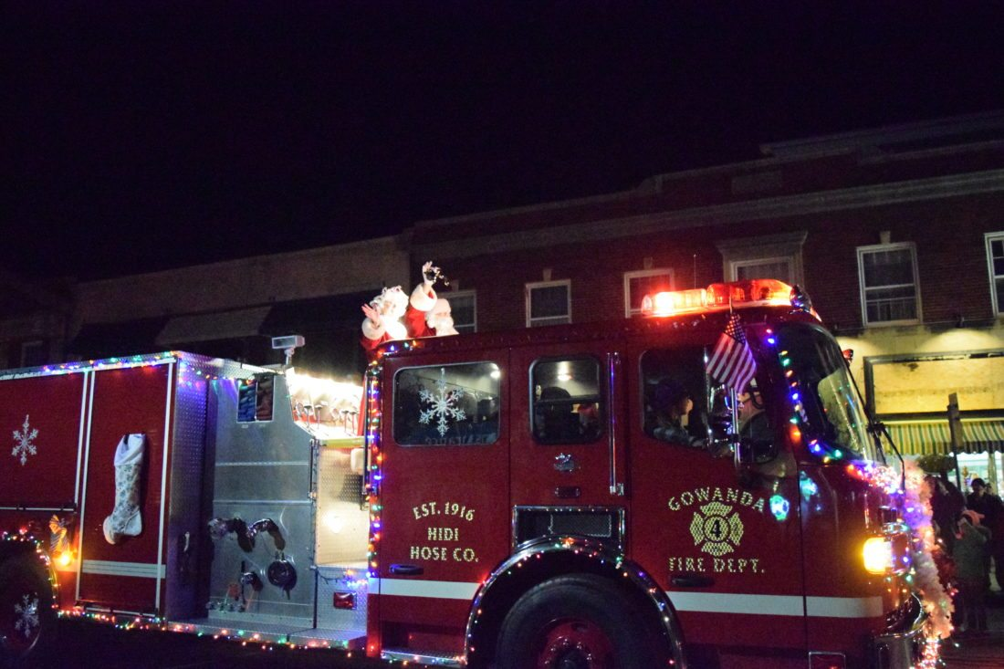 Mr. and Mrs. Claus wave to parade goers on a Gowanda Fire Truck.