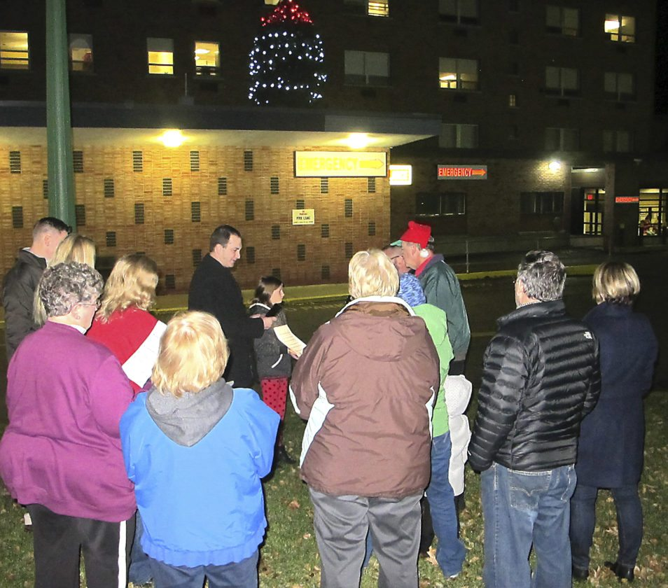 OBSERVER photo by Damian Sebouhian Carolers sing outside of Brooks Memorial Hospital to welcome in the holidays and take part in the traditional tree lighting ceremony.