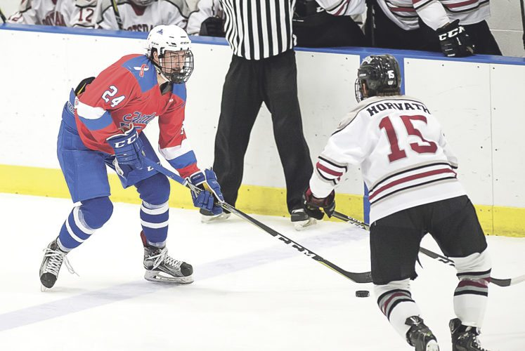OBSERVER Photo by Ron Szot Fredonia's Tyler Ritter (24) works up ice against Potsdam's Dom Horvath (15) during mens' ice hockey action Friday night, in Fredonia.