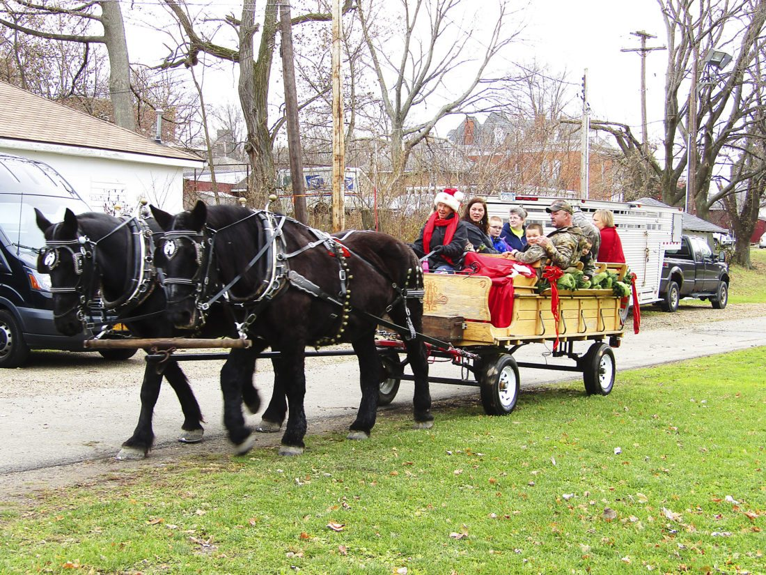 OBSERVER Photo by Greg Fox: Those who attended the Silver Creek Kiwanis Club's Christmas in the Park event Saturday had the chance to ride in a horse-drawn carriage.