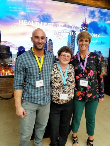 Submitted Photo From left, The Resource Center's Jon DeSantis, Donna Trusso and Heather Courtney are all smiles after learning that TRC had been named the country's 19th healthiest employer.