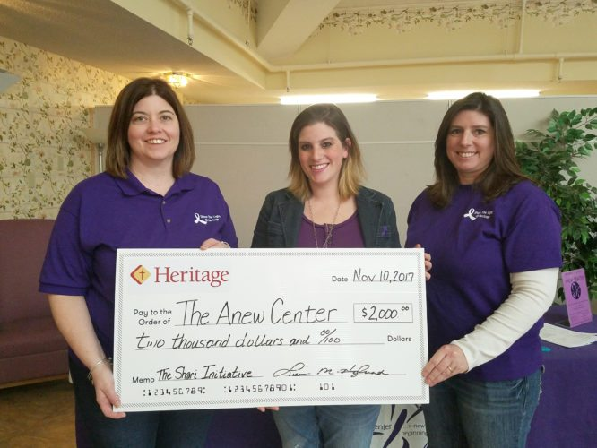 Submitted Photo Bethany Smart of the Anew Center was recently presented a check for $2,000 in memory of Heritage employee the late Shari Robbins. Pictured with Smart is Lisa Haglund, Heritage Director of Marketing and Development and Laura Blake, Heritage Corporate Human Resources Director.