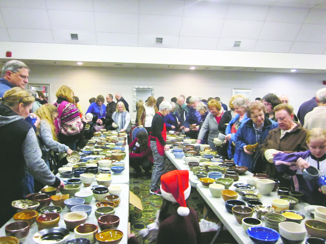 OBSERVER Photo by Diane R. Chodan On Saturday, the public browsed through the bowls offered for sale at the Empty Bowls event held at the Clarion Hotel in Dunkirk. Local potters create one of a kind bowls offered at a range of prices. After purchase, a bowl can be washed and filled with a choice of soup for a simple meal. All proceeds from the event benefit local food pantries.