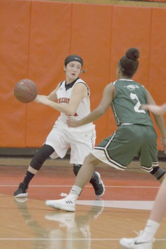 OBSERVER Photo by Mary Ann Wiberg Fredonia's Hannah Gullo dribbles while guarded by Lake Shore's Lani Cornfield (2) during Monday's non-league girls high school basketball game at Fredonia High School.