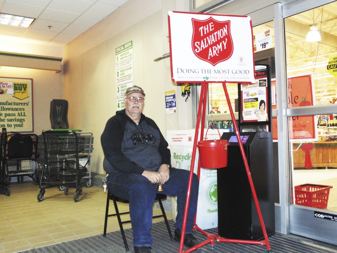 OBSERVER photo by Jimmy McCarthy Ed Dragon is pictured ringing the bell at the exit of Tops Markets. Dragon, who's a Navy veteran, says it's his first year volunteering for the Salvation Army's Red Kettle Campaign.