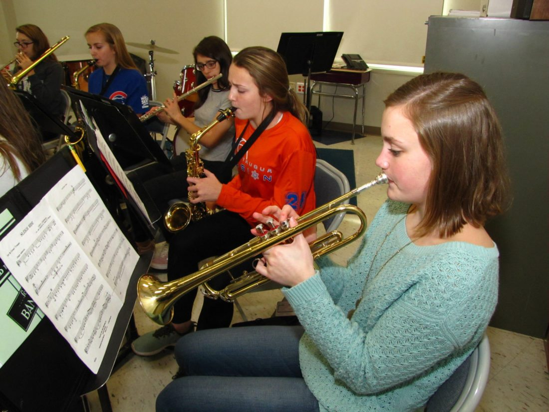 Submitted Photo Student musicians at Chautauqua Lake Central School rehearse for one of several winter performances to be held the week of Dec. 11 in the District Auditorium. Pictured from right to left are freshman band members Amelia Brown, trumpet; Kira Erickson, saxophone; and Isabella Gilmore, flute; and seniors Corinne Elliott, saxophone; and Makayla Alexander, trombone.
