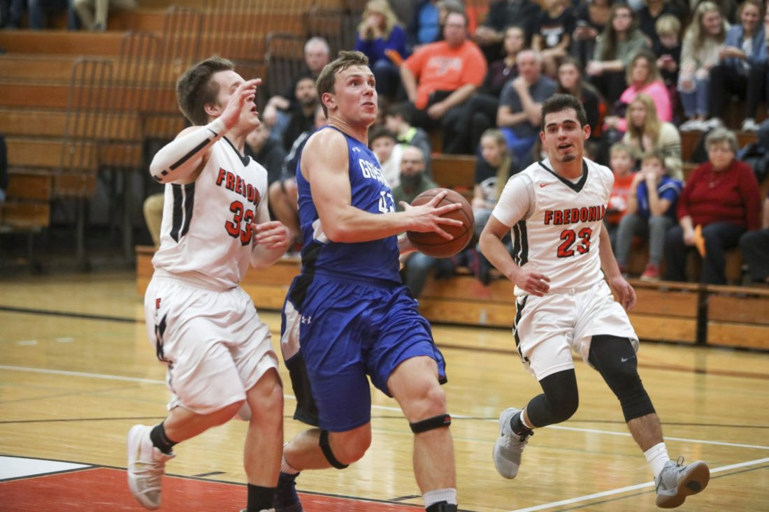 OBSERVER Photo by Joe Conti Gowanda's Ture Hassler drives as Fredonia's Nico Pucci (23) and Andrew Field (33) pursue during Wednesday night's high school basketball game. Gowanda won, 61-55.