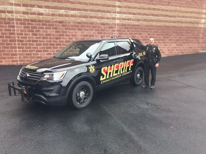 Photo by the Chautauqua County Sheriff's Office Sheriff Joe Gerace is pictured with the department's new Ford Interceptor Utility patrol vehicle. The Chautauqua County Sheriff's Office is upgrading its entire fleet while also introducing a new design, from white and red to black and gold coloring.