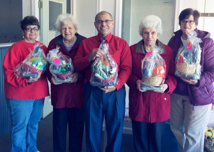 Submitted Photo St. Columban's on the Lake recently delivered relief baskets to local Hurricane Maria survivors. Pictured are volunteer Candace Kuppel, resident Pat Flitt, Dunkirk City Clerk Edwin Ramos, resident Lucy Spinuzza and volunteer Sylvia Patterson.