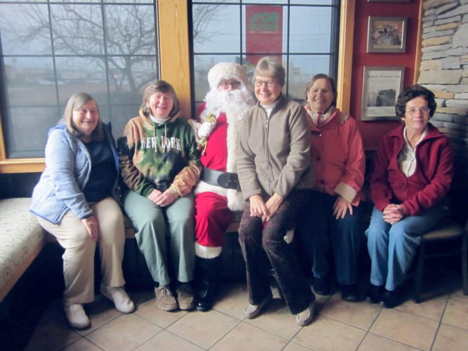"OBSERVER Photo by Diane R. Chodan The ""French horn section"" of the New Horizons Band got together for an activity-filled day on Saturday, starting with the annual pancake breakfast at Applebee's to benefit Girl Scout Troop 20158. After breakfast the group planned to attend events, including the Friends of the WCA ornament sale, the nativity display and alternate Christmas market in Fredonia, and the Empty Bowls event in Dunkirk. Pictured from left are: Alona Forbes of Dunkirk, Molly Golando of Fredonia, Santa Claus, and Carole Okey, Pauline Emilson and Phyllis Noble, all of Westfield."
