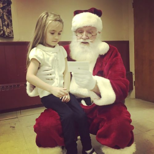Emerson Dodd gives Santa a Christmas card at the Breakfast with Santa event in Westfield. It was a magical Christmas moment!