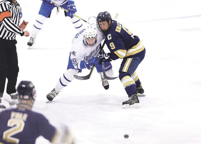 OBSERVER Photo by Joe Conti Fredonia's Josh Biasillo battles for positions against Canton's Kasey Kulczycki during Saturday's hockey game in Steele Hall, at SUNY Fredonia.