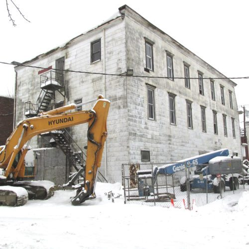 OBSERVER Photo by Damian Sebouhian Snow adorns an excavator parked behind the old Revere Inn in Silver Creek. The demolition project, originally scheduled for Tuesday, has been rescheduled for tomorrow morning around 10 a.m.