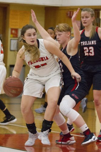 OBSERVER Photo by Mary Ann Wiberg Fredonia's Katie Price dribbles while being guarded by Southwestern's Erin Radack, as Izzy Bursch (23) looks on, during high school basketball action Wednesday at Fredonia High School.