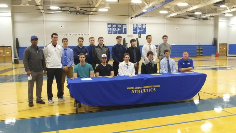 Submitted Photo Sam Mullen, third from left in the back row, and Derrick Walters, fourth from right in the back, participate in an athletes' signing ceremony at Niagara County Community College. Mullen, a Silver Creek senior, and Walters, a Fredonia senior, will play baseball at the college.