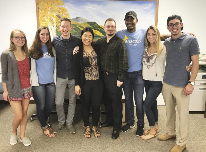 "Submitted Photo Sunisi ""Bo"" Sirijindaphan (center) is joined by members of the Enactus team that worked on the Siri Thai Cuisine project: Katelyn Killoran ('18, graphic design), Paige Halter ('18, marketing), Dan Bertloff ('18, management), Professor Justin Mindzak, Latrell Tyson ('18, marketing), Nicole Lyons ('18, public relations/communication) and Nate Winn ('18, marketing)."
