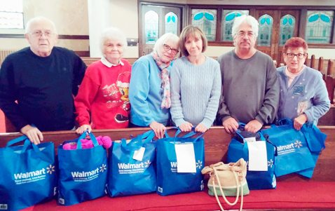 Submitted Photo Pictured are some of the participants in the Willow Mission effort to make Christmas a little nicer for some area families. From left: Bob Block, JoEllen Sherman, Sharon Kelly, Janine DeGolyer, Chuck Eckert and Barb Block. Not pictured are Rev. Jim and Linda Bailey, and Judy Cole.