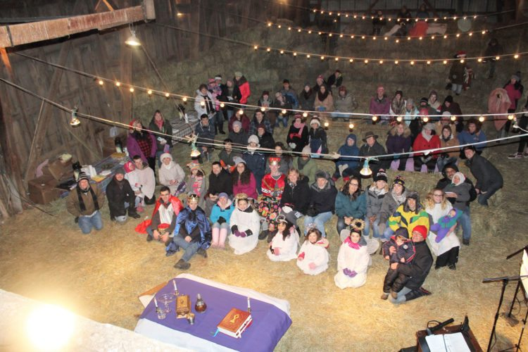 Submitted Photo The 24th Annual Christmas Barn Mass in Forestville was held on Dec. 16 in the barn of John and Aimee Rogers' family farm.