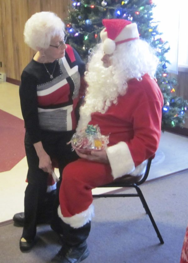 OBSERVER Photos by Diane Chodan Marie Emke is pictured with Santa.