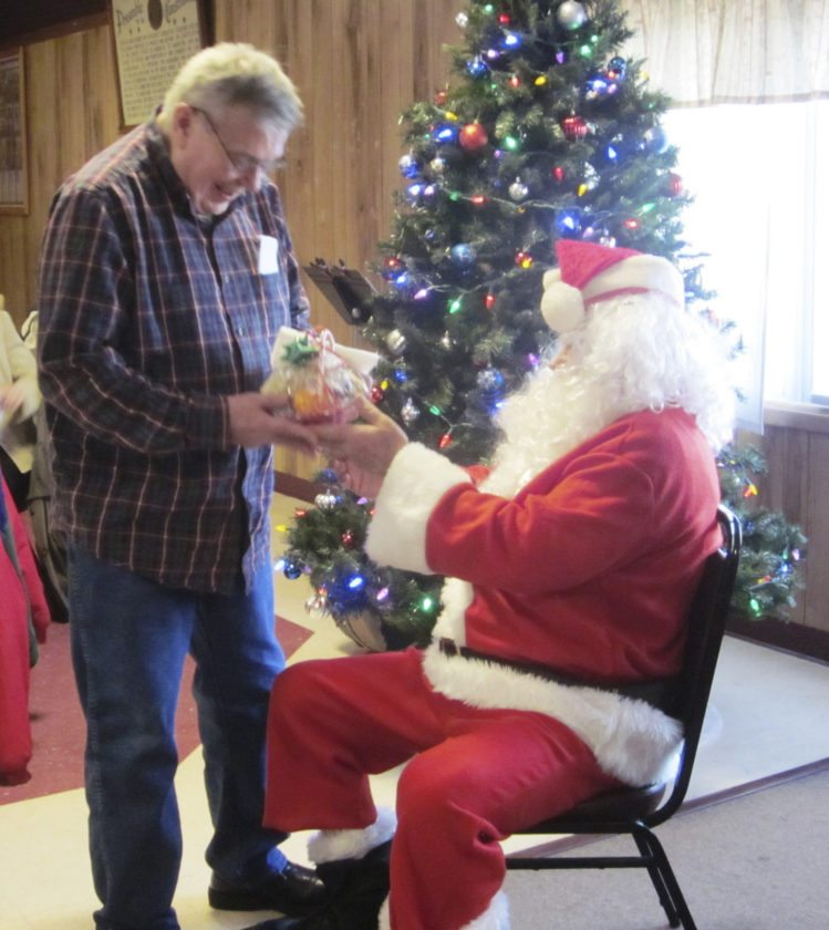 David Van Rensselaer received a gift, but politely declined to sit on Santa's lap.