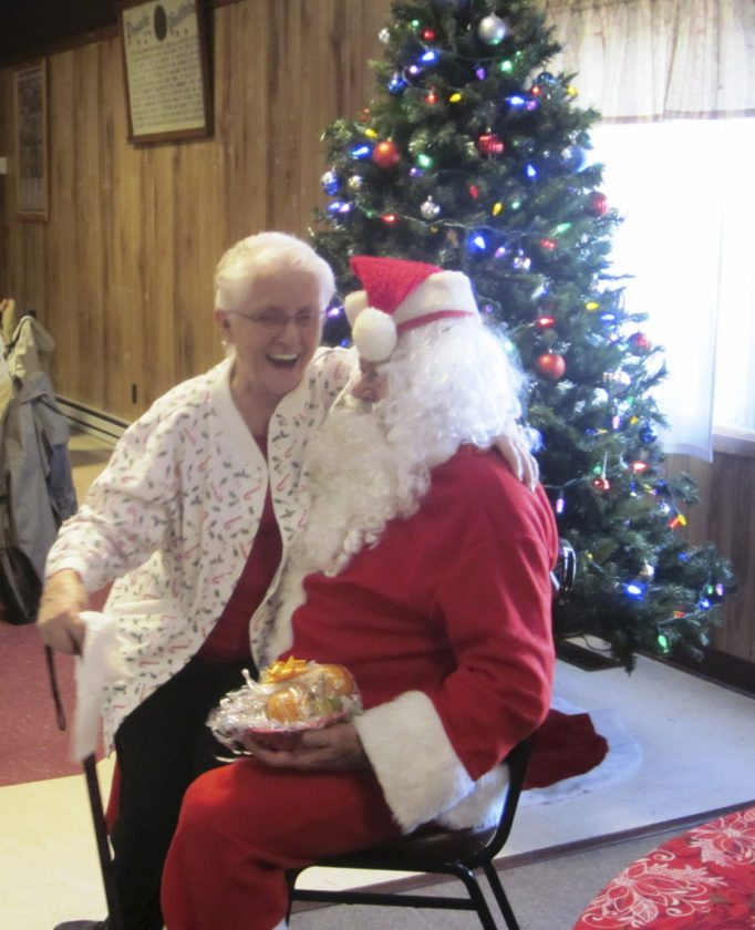 Liz Stahlman has a serious conversation with Mr. Claus.