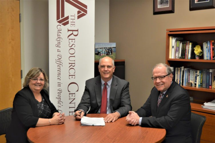 Submitted Photo Denise Jones, The Resource Center president and chief executive officer; Randy Ordines, TRC Foundation, Inc. chair; and Randy Sweeney, Chautauqua Region Community Foundation executive director, complete the necessary paperwork to transfer TRC Foundation's $2.2 million in assets to the Community Foundation.