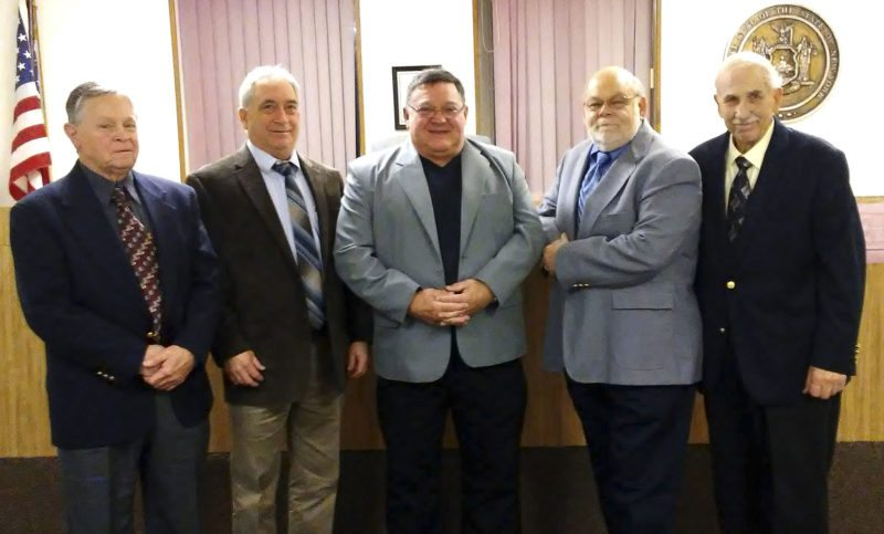 OBSERVER Photo by Damian Sebouhian Outgoing Silver Creek Mayor Nick Piccolo, center, is pictured with the village board of trustees John Burt, Warren Kelly, mayor-elect Jeffrey Hornburg and Vince Tampio.