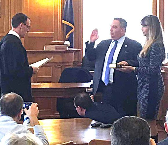 Submitted photo Above:County Executive George Borrello was accompanied by his wife, Kelly, as he took his oath of office on Monday. Judge Dave Foley officiated the ceremony.