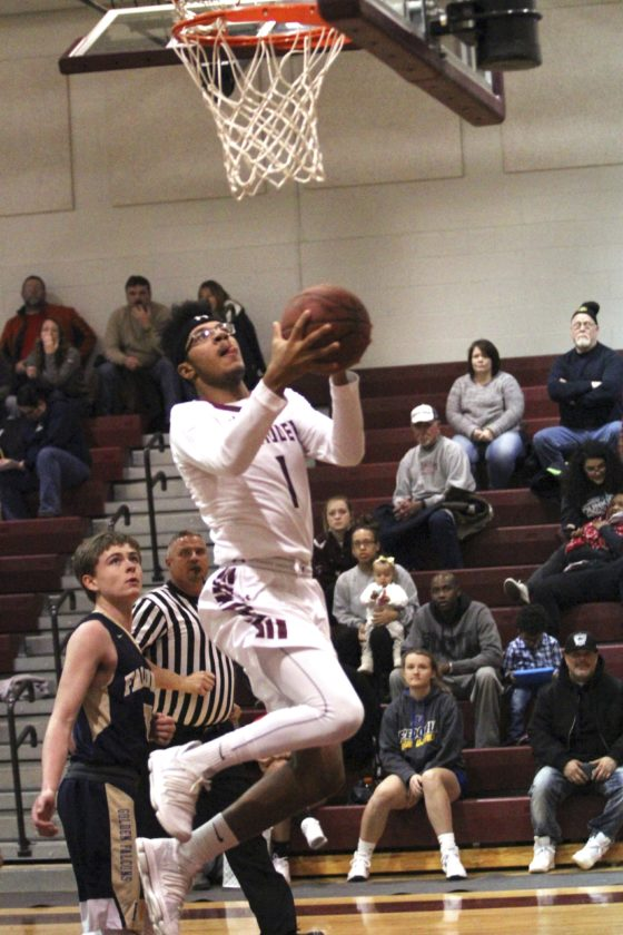 OBSERVER Photo by Lisa Monacelli Dunkirk's Darnell Butts (1) goes in for a layup during the Marauders' win over Falconer Tuesday at Dunkirk High School.
