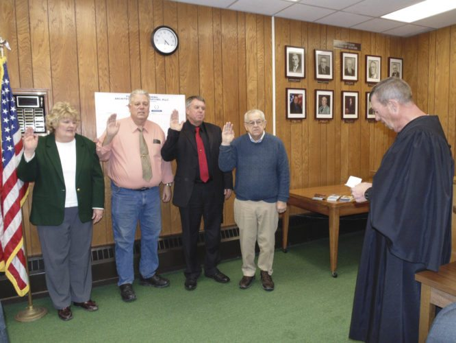 OBSERVER photo by Jimmy McCarthy Town of Dunkirk officials were sworn in during an organizational meeting Tuesday. Pictured from the left are Jean Crane, town clerk, Richard Purol, town supervisor, Chris Penfold, town justice and Robert Penharlow, town councilman.